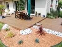 Création d'une terrasse en composite TREX  par SUISSE VERTE PAYSAGE à ETERVILLE (14)